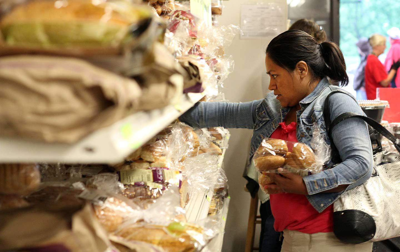 California Food Stamps A Woman Reaches For Bread On Churchs Shelf AP Photo Laura Yuen