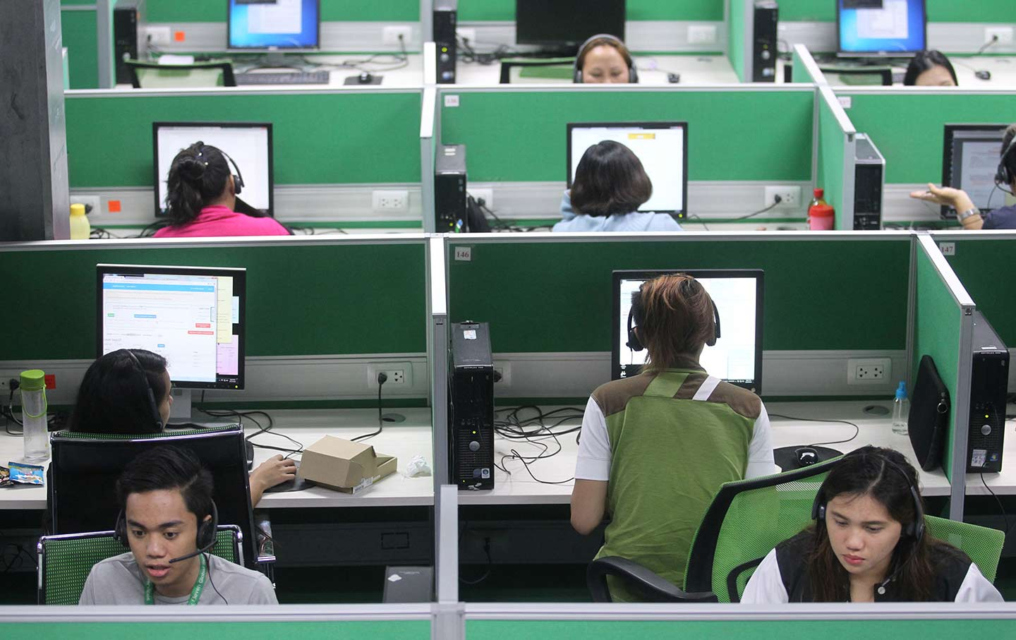 Employees work at a call center in Davao City in the southern Philippines  on December 13, 2016. (Reuters / Lean Daval Jr.)