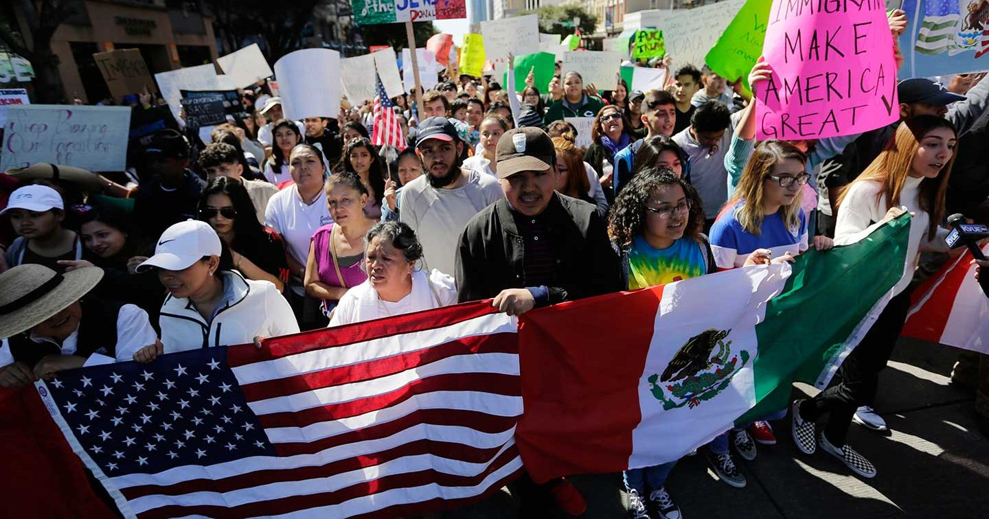 A group marches through downtown Austin heading to the Texas Capitol during an immigration protest, Thursday, Feb. 16, 2017.