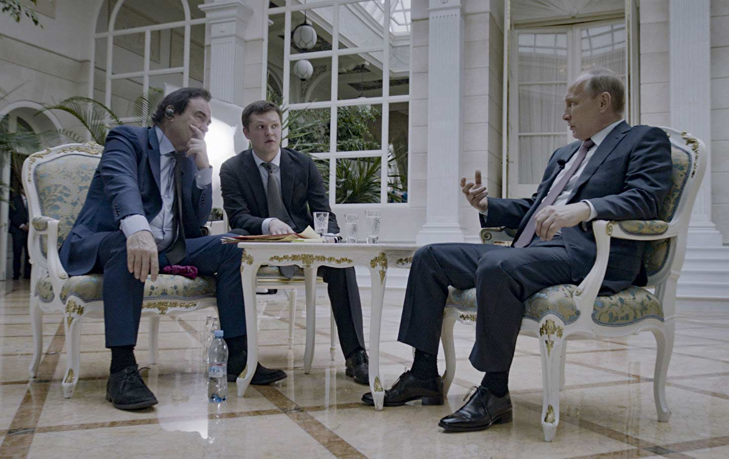 Oliver Stone, interpreter Sergei Chudinov, and Russian President Vladimir Putin in a scene from the Showtime documentary. (Komandir / Courtesy of Showtime)
