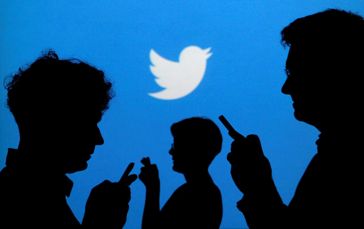 Twitter logo and silhouettes