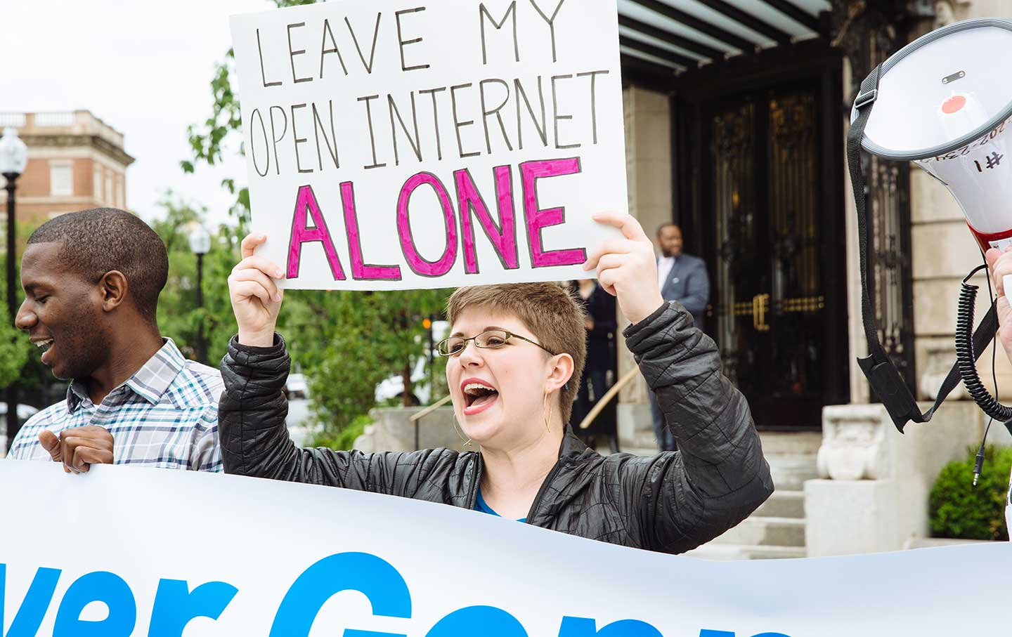 Activists gather outside American Enterprise Institute to protest FCC Chairman Ajit Pai and the Trump administration's attacks on net neutrality.