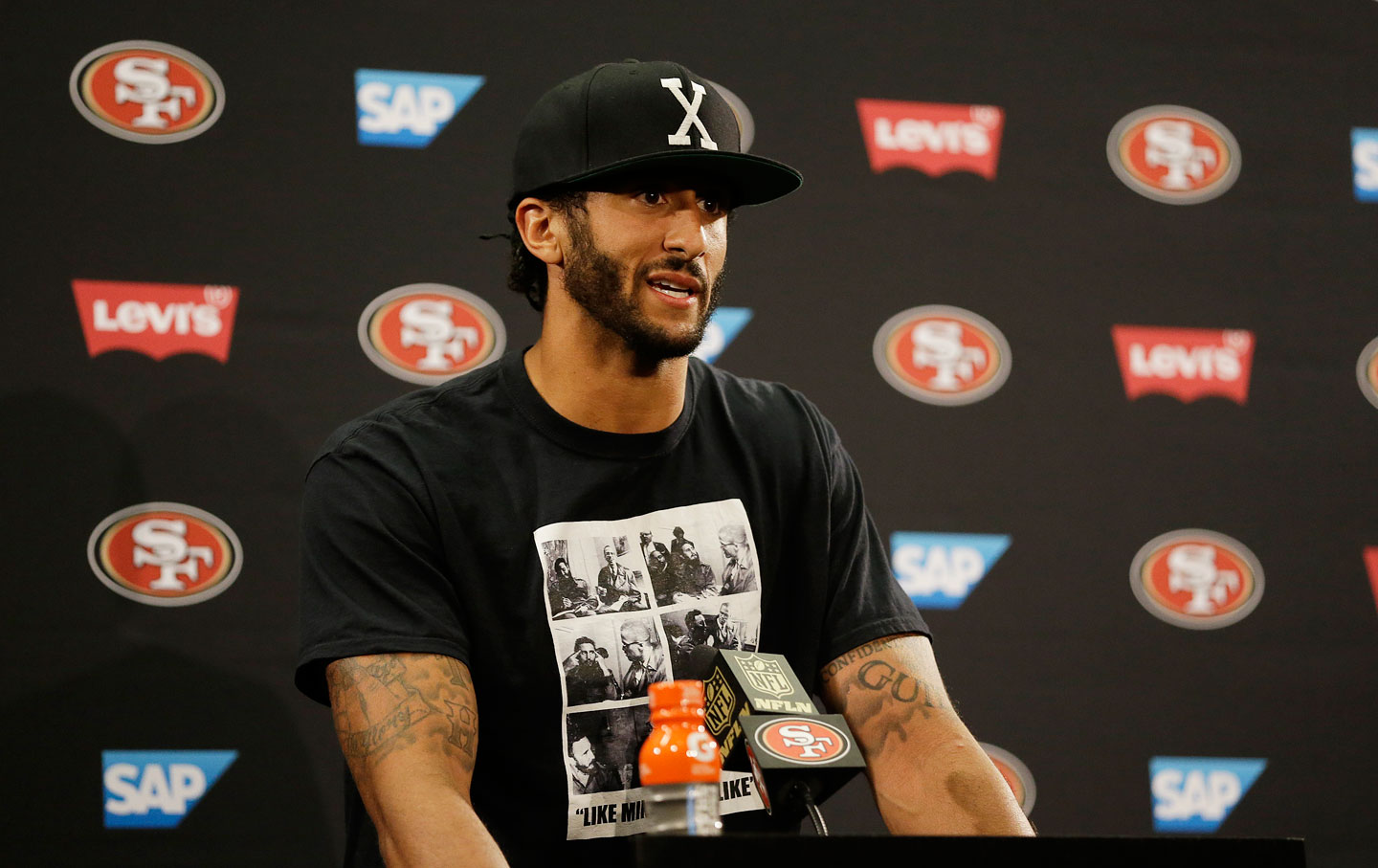 Colin Kaepernick answers questions at a news conference on August 26, 2016.