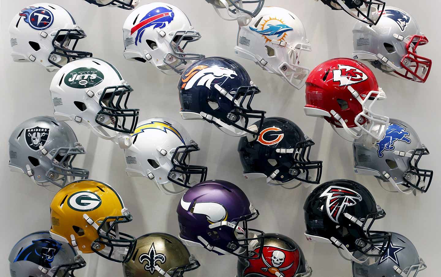 NFL team helmets on display at the NFL Headquarters in New York on December 3, 2015.