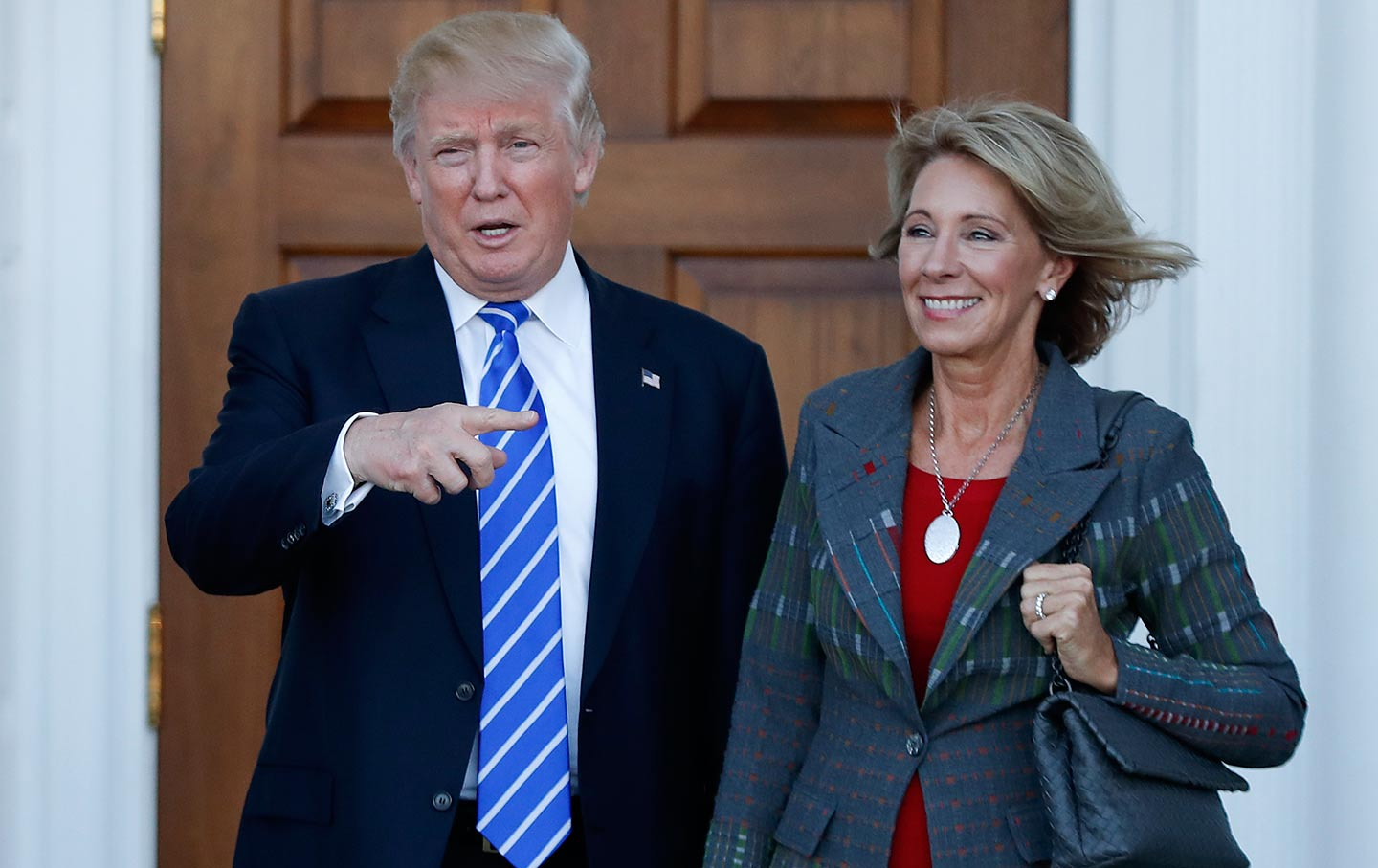 b34a83752c7ff President Donald Trump and Betsy DeVos pose for photographs at Trump  National Golf Club Bedminster clubhouse in New Jersey. (AP   Carolyn Kaster)