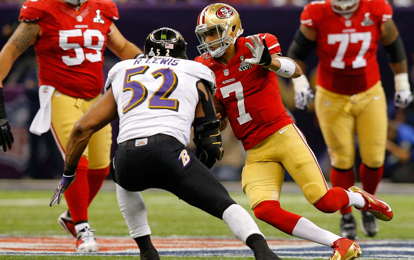 Ray Lewis (52) chases San Francisco 49ers quarterback Colin Kaepernick (7) during the NFL Super Bowl XLVII game on February 3, 2013.