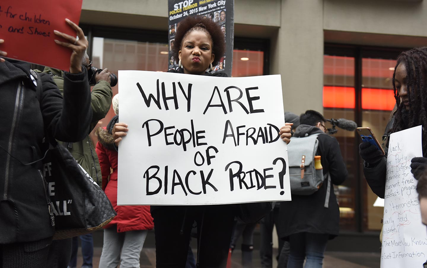 A Black Lives Matter supporter holds a sign in front of the NFL headquarters as part of a demonstration on February 16, 2016.