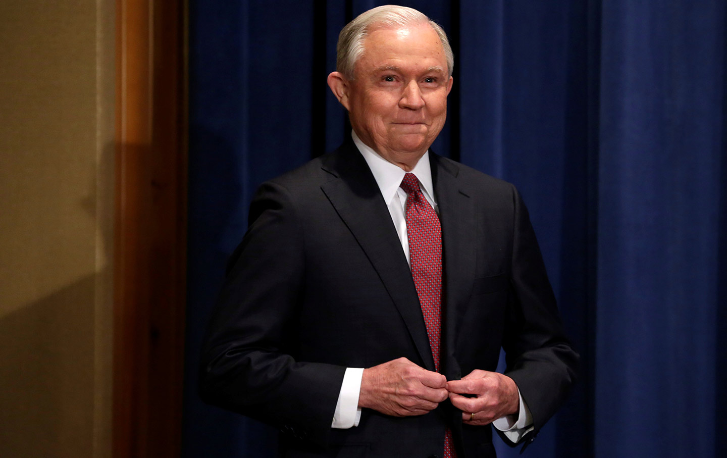 Sessions arrives at the news conference