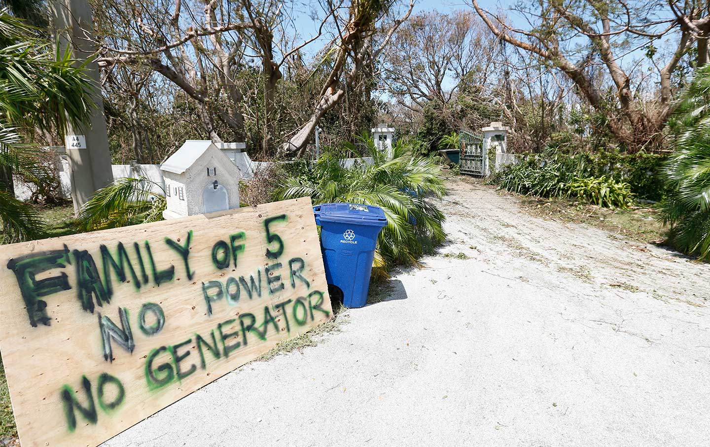 A sign outside a home where a family rode out Hurricane Irma in Key Largo, FL., in the Florida Keys.