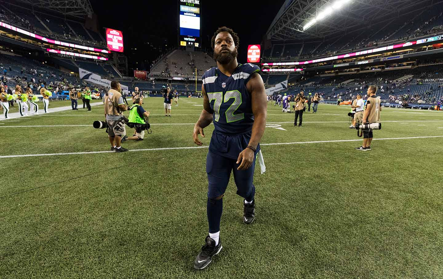 Michael Bennett walks during an NFL preseason football game