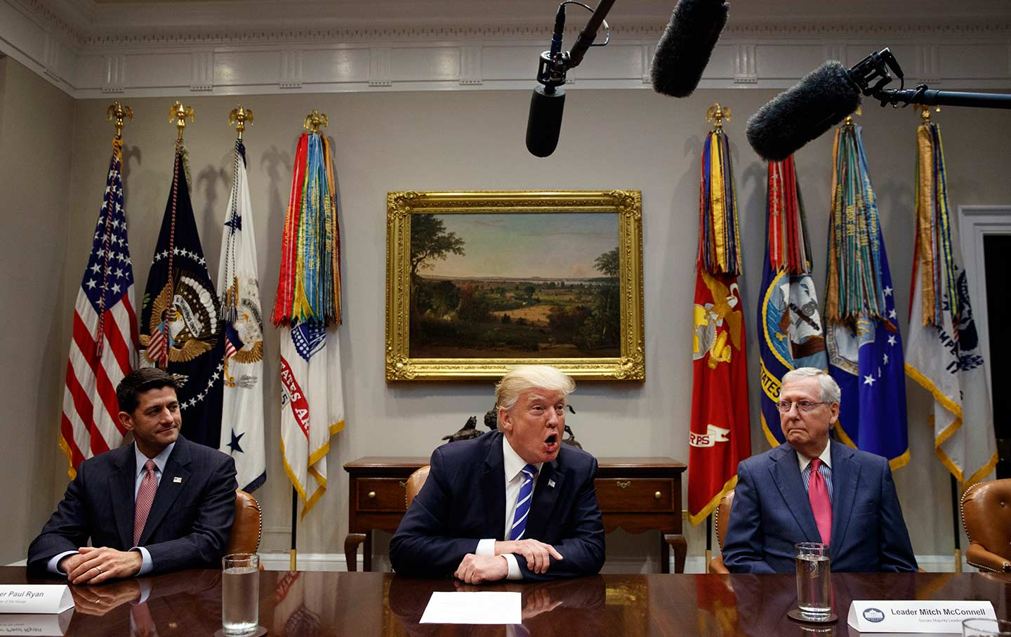 House Speaker Paul Ryan, left, and Senate Majority Leader Mitch McConnell, right, listen as Donald Trump speaks during a meeting on tax reform in the White House on September 5, 2017.