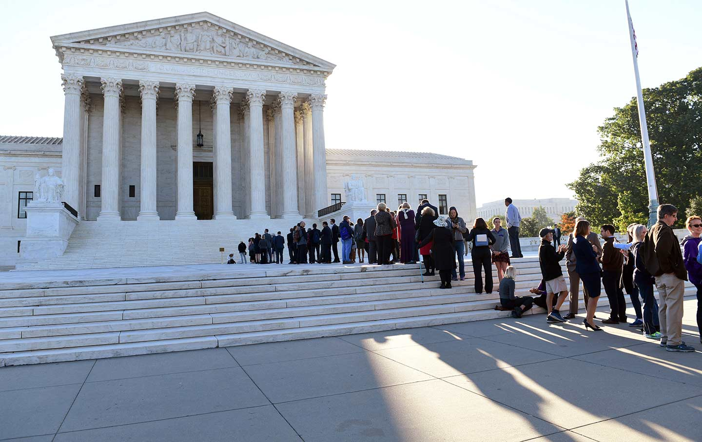 People wait outside the Supreme Court