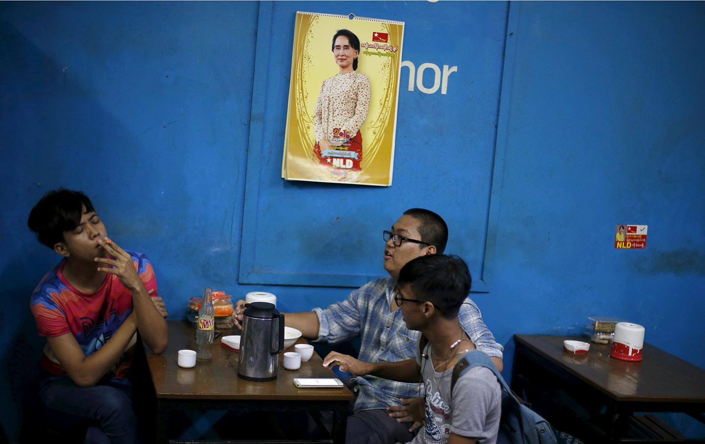 The Fall Of Aung San Suu Kyi Democracy Icon  The Nation Men Sit In A Tea House In Yangon Under A Calendar With A Picture Of Aung  San Suu Kyi Reuters  Jorge Silva Making A Thesis Statement For An Essay also Environmental Health Essay Essay Examples For High School