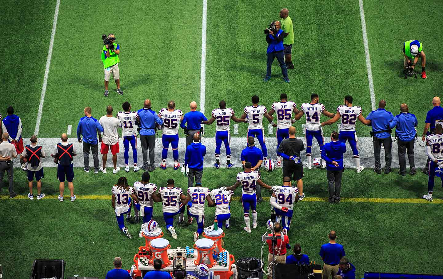 21ab529d169c An overhead view of the Buffalo Bills as players lock arms and kneel during  the national anthem on October 1