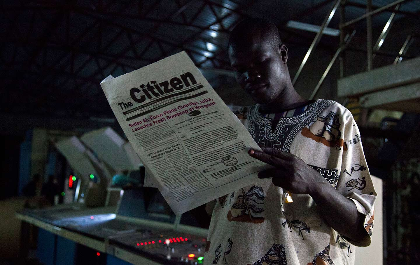 Reading a Newspaper in South Sudan