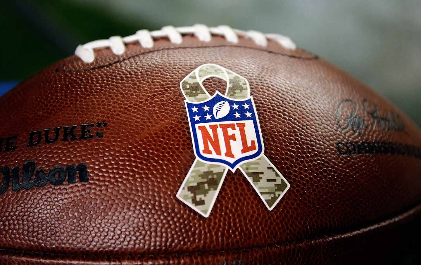 88834278dd8 The NFL Salute to Service logo is seen on a football during an NFL football  game on November 12, 2017. (AP Photo / Jack Dempsey)