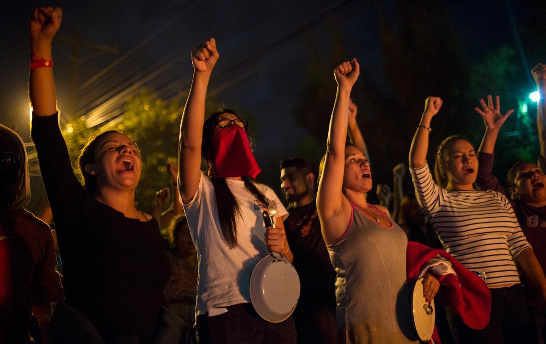 Honduras-Curfew-Protest-AP