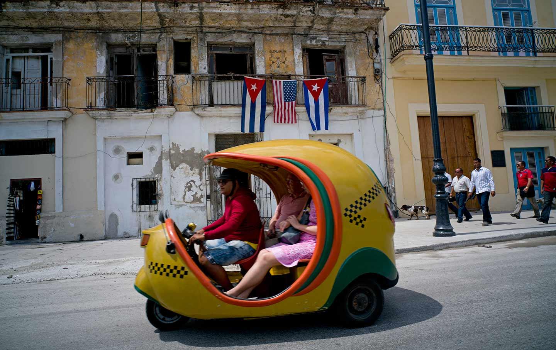 Tourists in Havana taxi