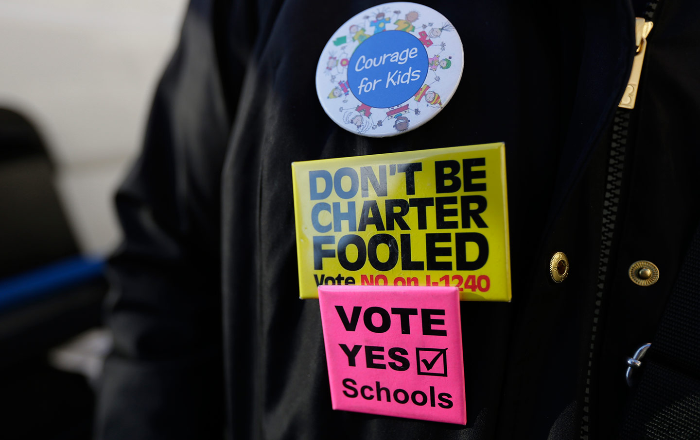 Buttons opposing charter schools
