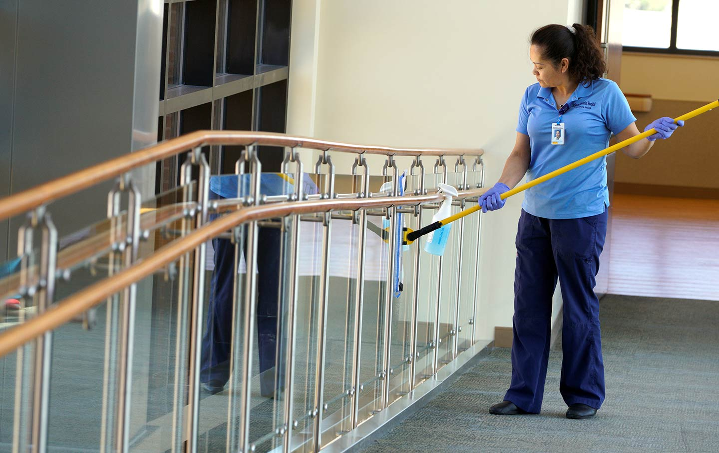 Housekeeper Rosalinda Franco cleans the glass at Littleton Adventist Hospital in Colorado, May 3, 2016