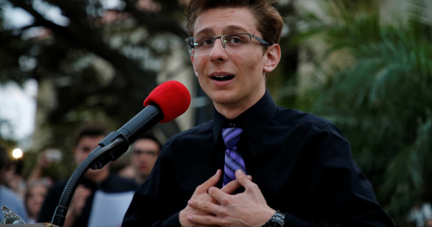 Dylan Baierlein, a student at Marjory Stoneman Douglas High, speaks to protesters at a Call To Action Against Gun Violence rally by the Interfaith League and others in Delray Beach, Florida.