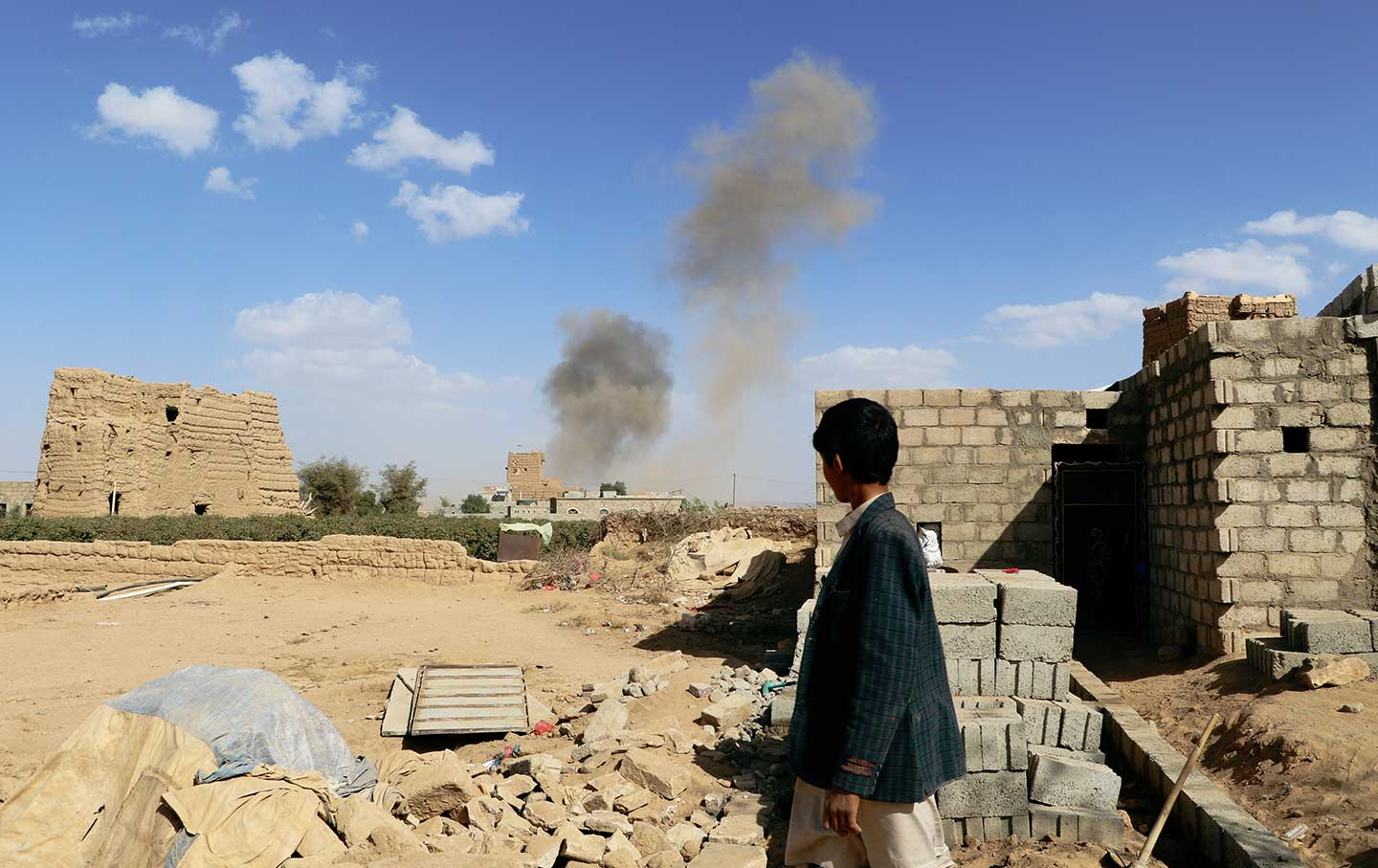 Boy watches airstrike Yemen