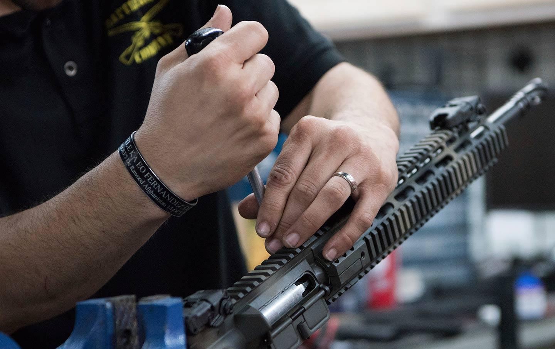 Man installing gun parts