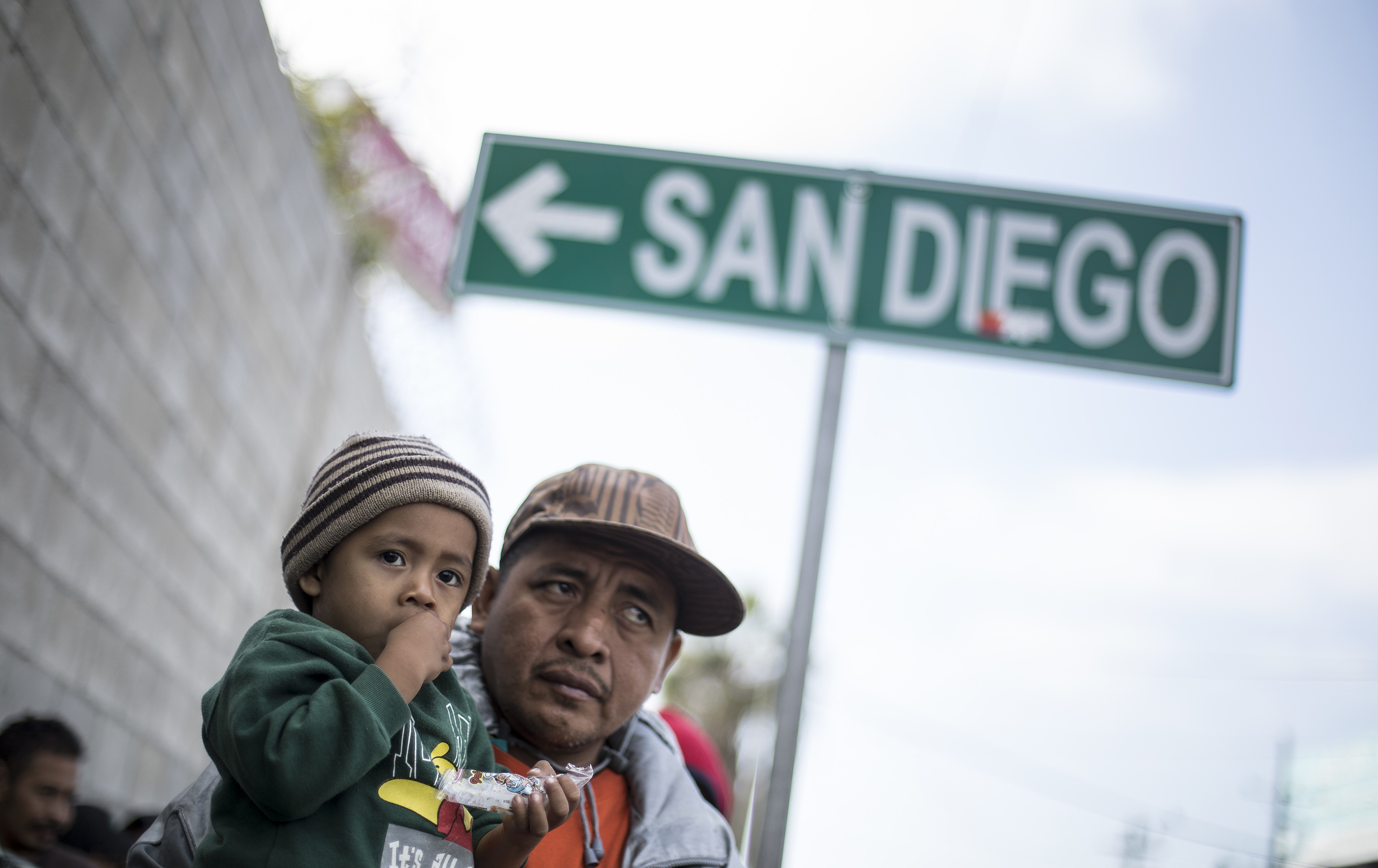 A father and his son await tutorship by immigration lawyers in Tijuana, Mexico, Friday, April 27, 2018.