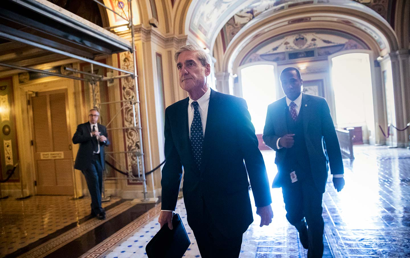 Mueller walks through halls of capitol building