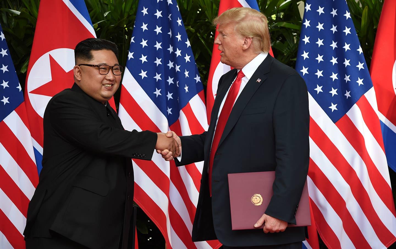 Trump Kim hand shake