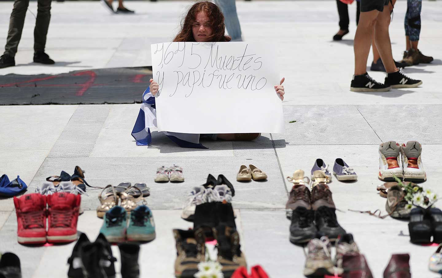 In San Juan, people leave shoes to represent the victims of Hurricane Maria.