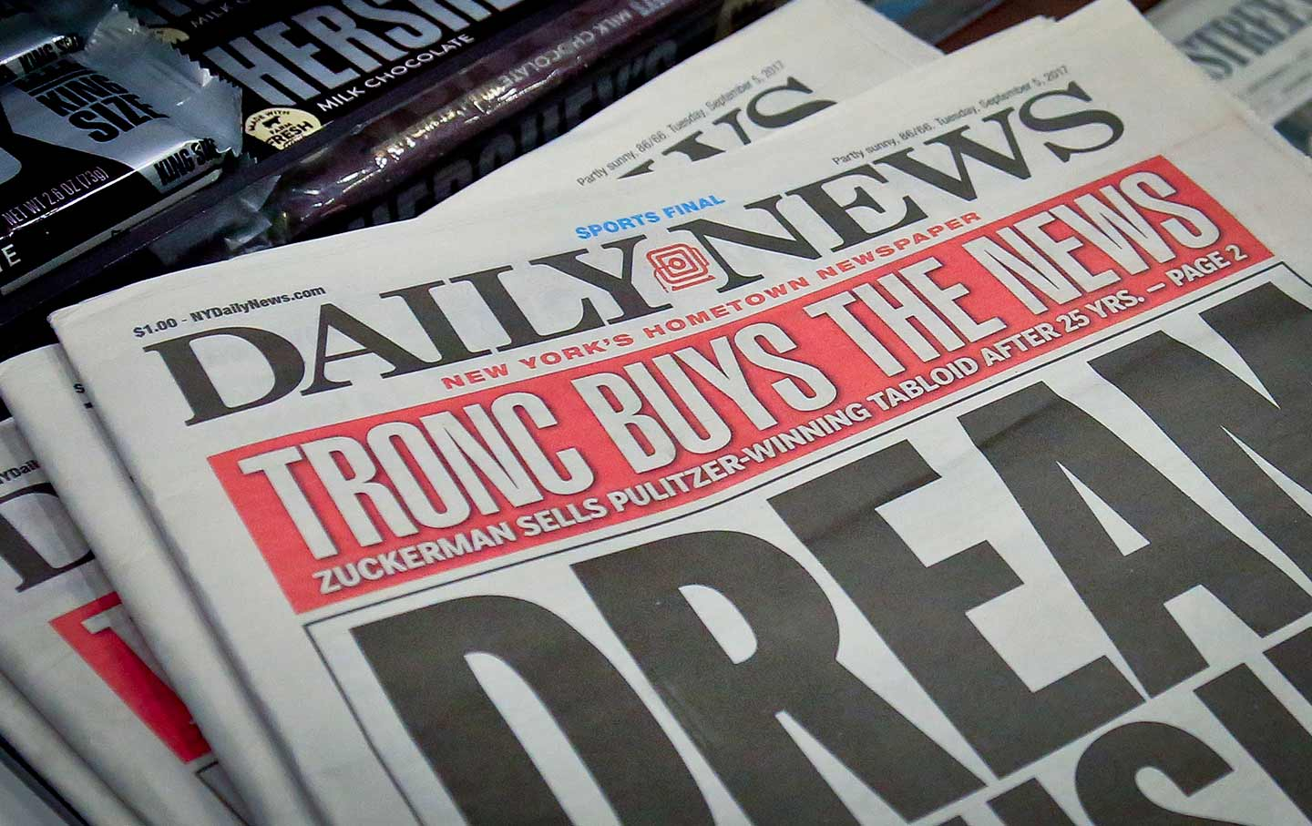 Copies of the Daily News announcing Tronc's acquisition of the paper in  September 2017. (AP Photo / Bebeto Matthews)