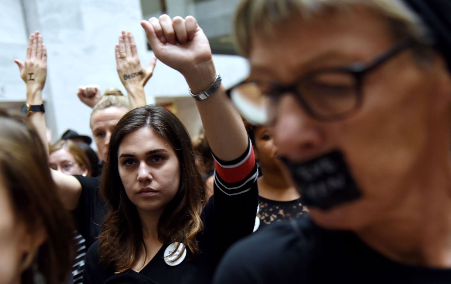 Demonstrators opposed to the Supreme Court nominee Brett Kavanaugh protest inside the Hart building on Capitol Hill.