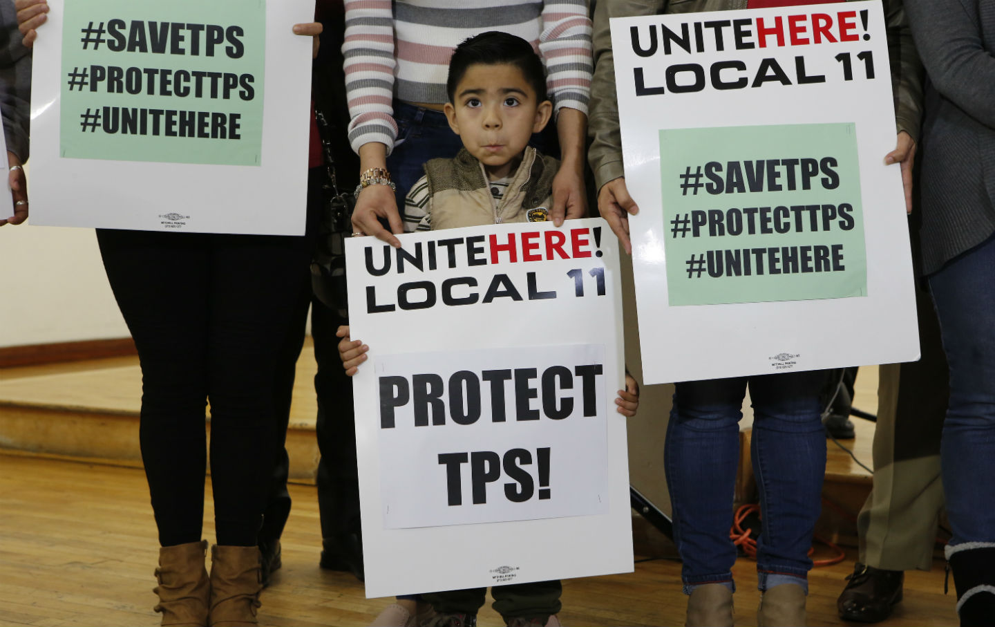 Mateo Barrera, 4, originally from El Salvador, whose family members benefit from Temporary Protected Status, attends a news conference in Los Angeles.