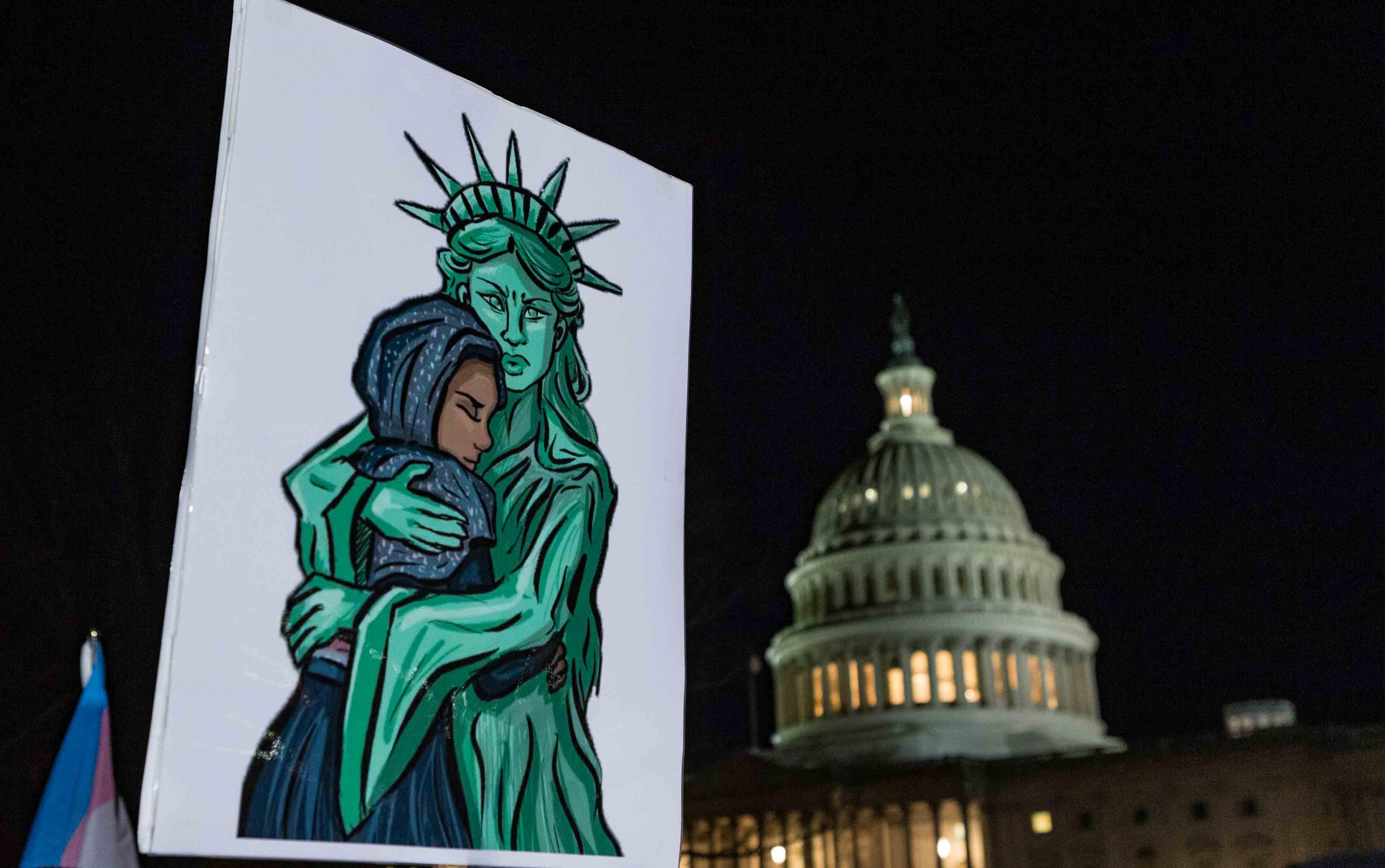 US Capitol vs Statue of Liberty hugging an immigrant