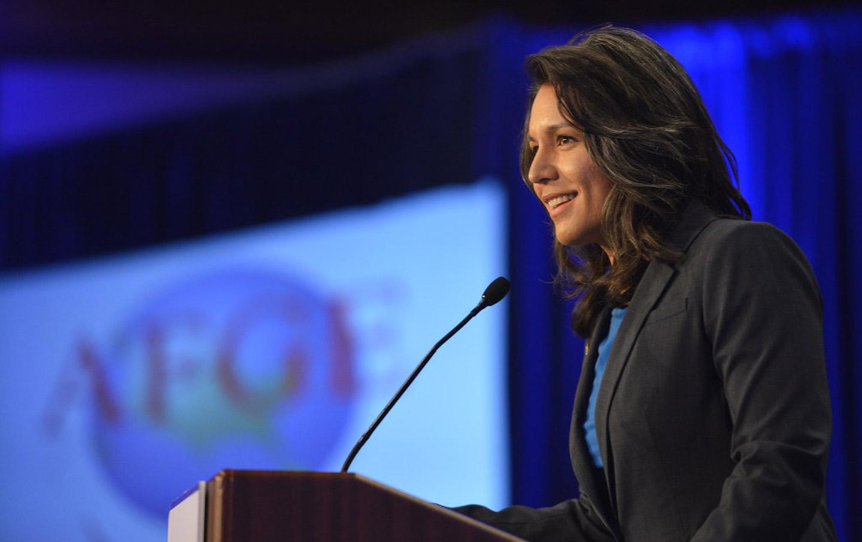 Tulsi Gabbard speaking at podium