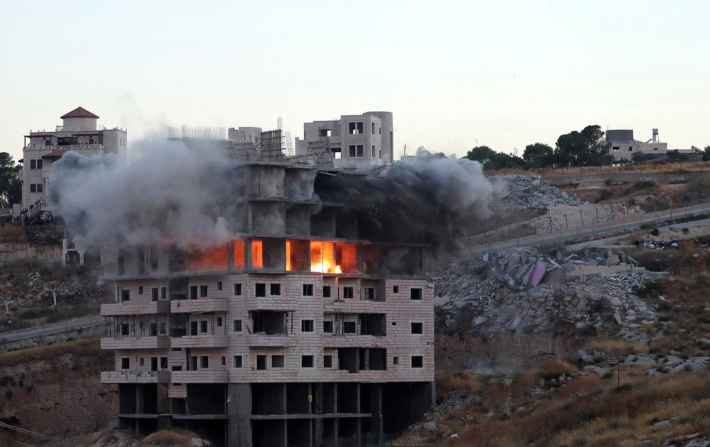 Image: Israeli forces blow up a Palestinian building in the village of Sur Baher on July 22. (Reuters / Ammar Awad)