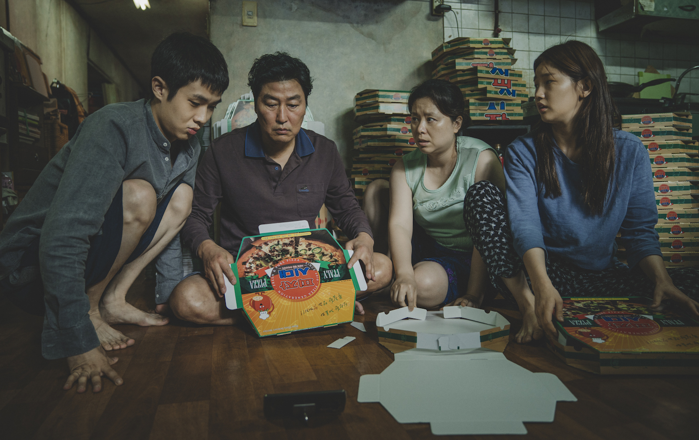 The Kim Family (Woo-sik Choi, Kang-ho Song, Hye-jin Jang, So-dam Park) in Parasite. Courtesy of NEON + CJ Entertainment