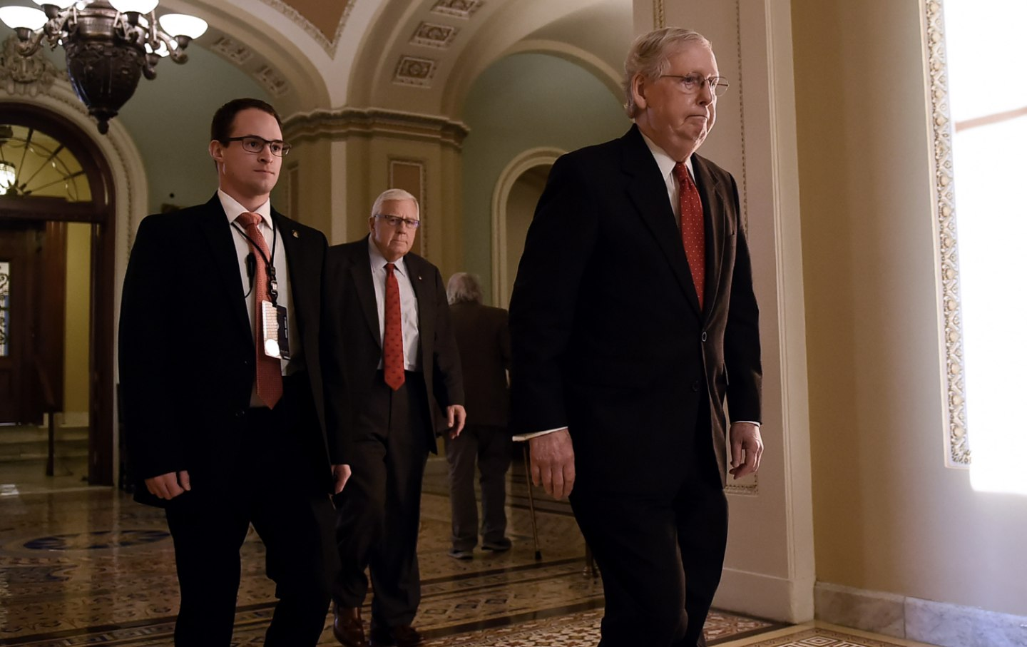 Mitch McConnell leaves the Senate chamber on recess from impeachment trial.