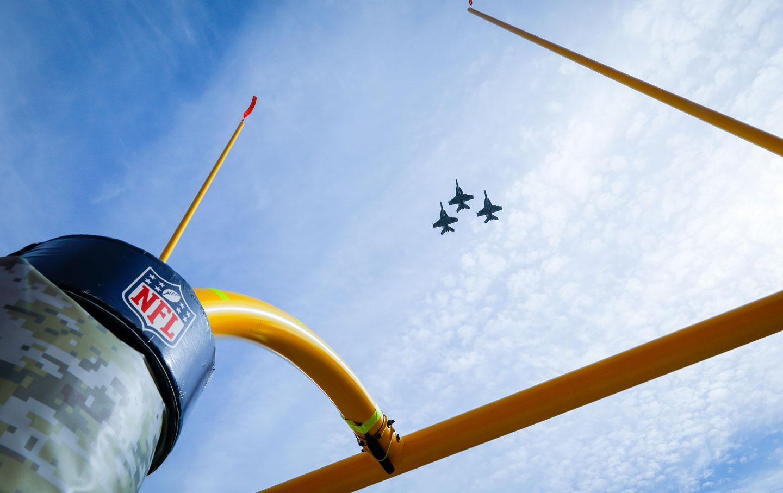 Military jets fly over Arrowhead Stadium