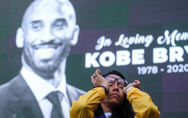 Woman at a Kobe Bryant memorial