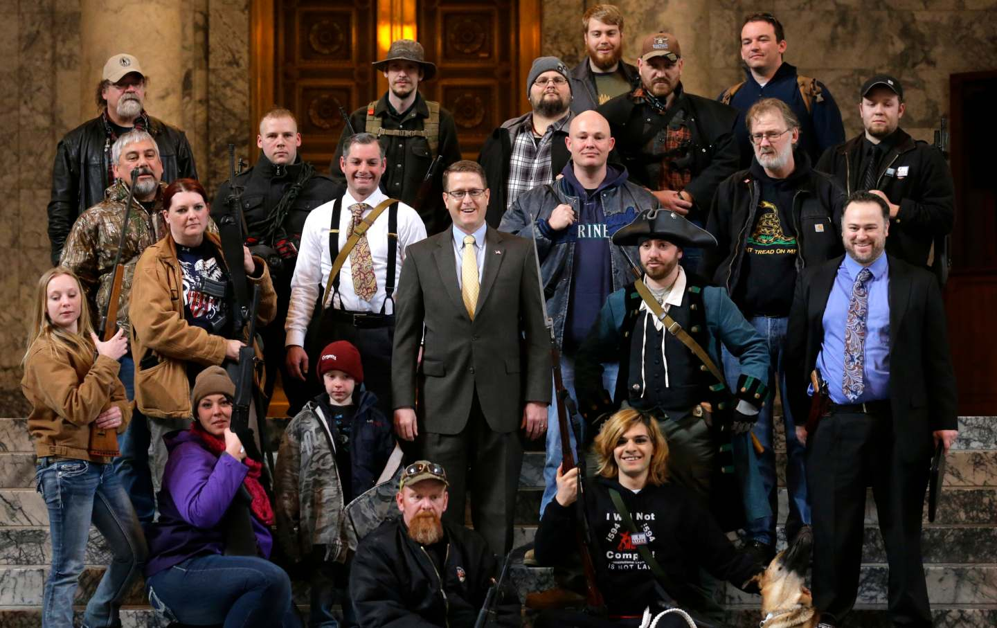 Matt Shea poses with gun-rights activists in a group photo