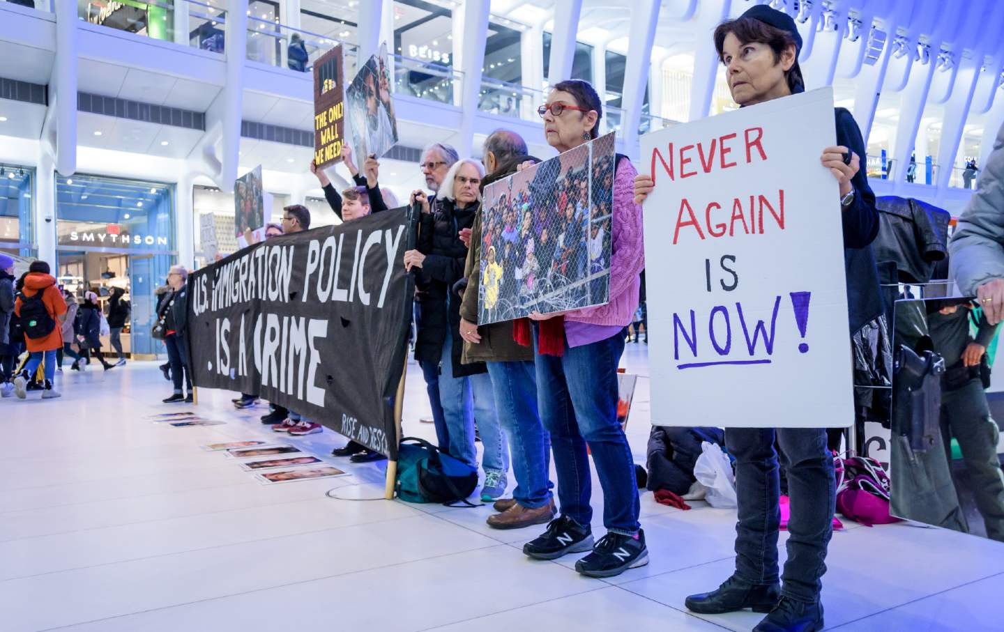 Members of the activist group Rise And Resist gather in silent protest
