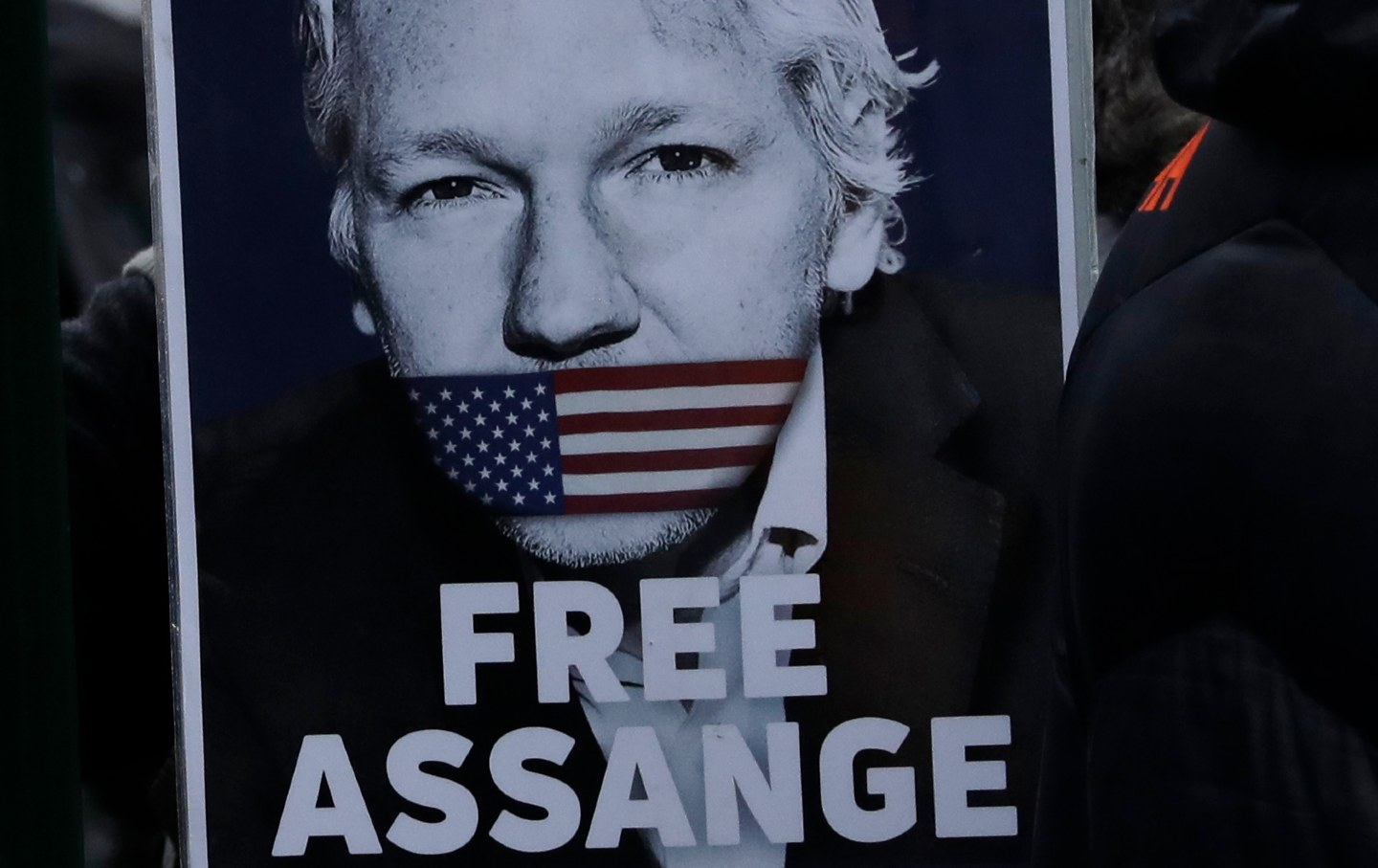 Poster of Julian Assange that says