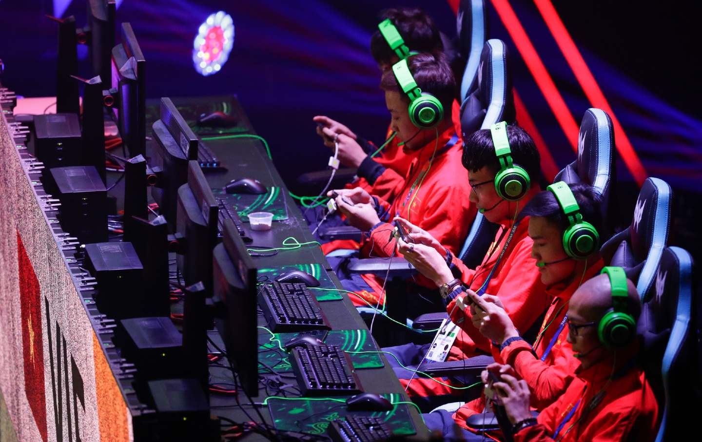 A row of gamers concentrating during an esports competition.