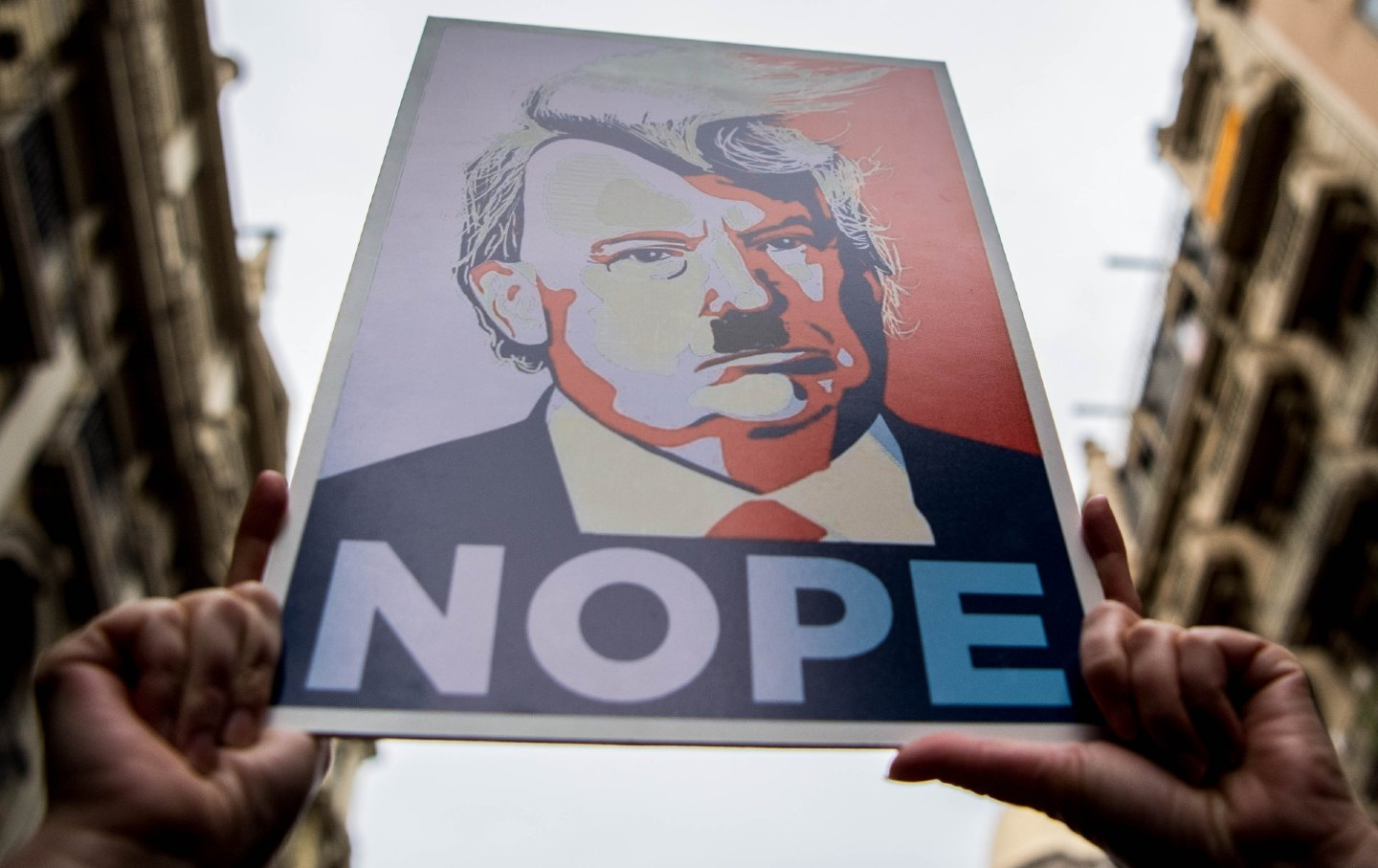 Poster of Trump at a women's march rally that says