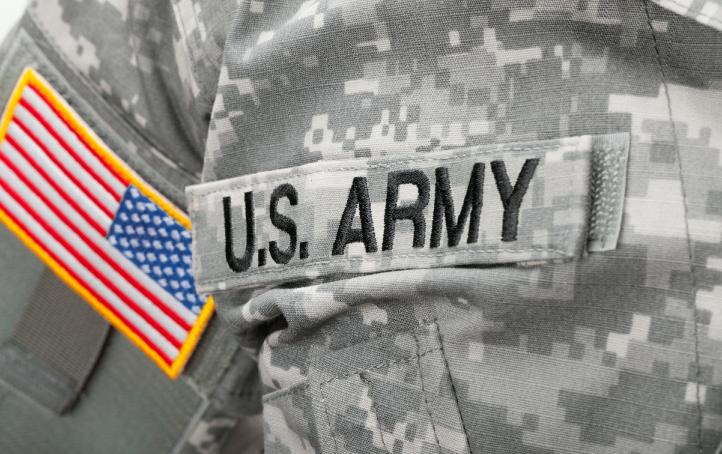 US Army and flag patch on solder's uniform