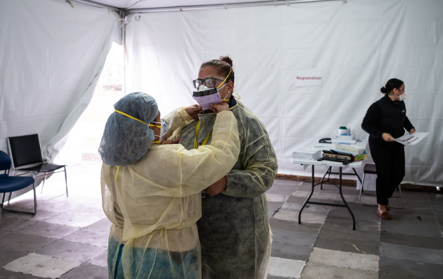 Nurses adjust protective masks
