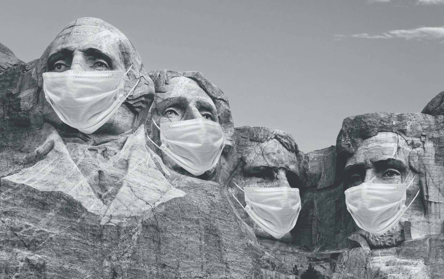 The faces on Mt. Rushmore wearing surgical masks