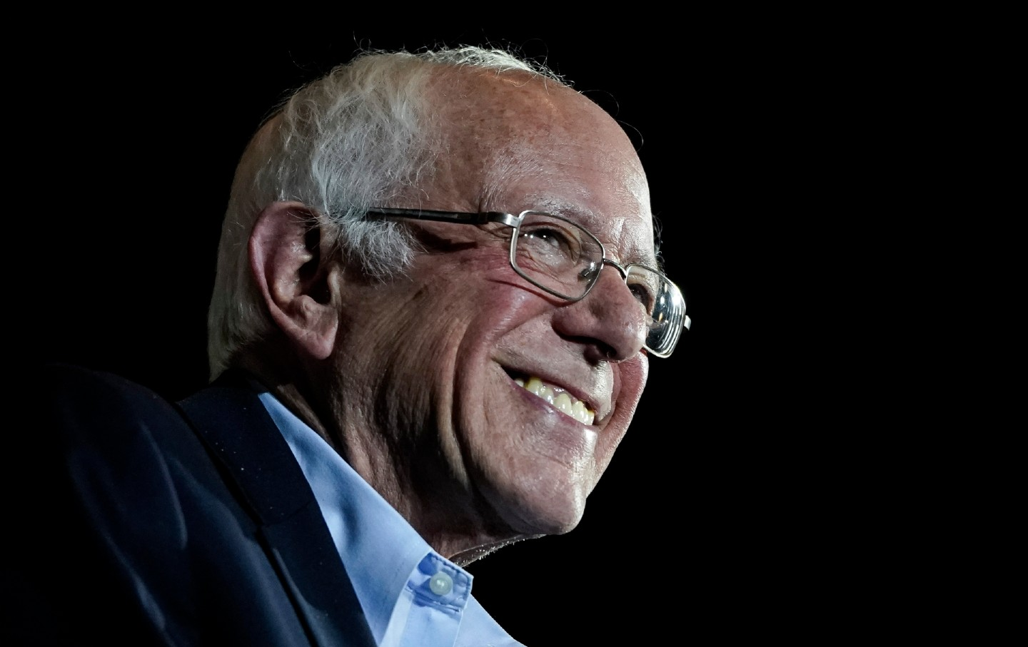 Close-up shot of Bernie Sanders smiling.